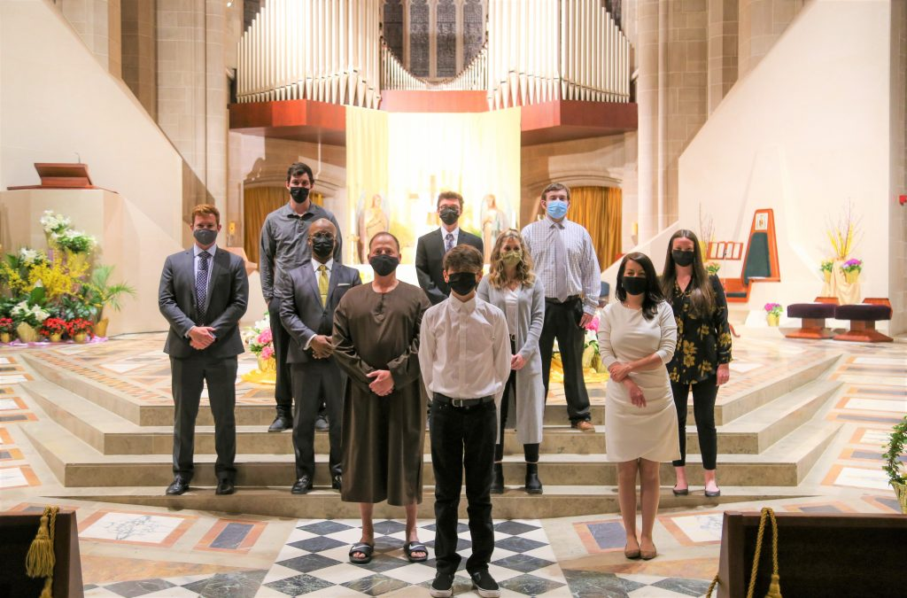A group of 10 people standing in front of the altar.